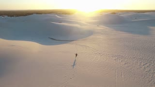 Aerial Shot of Sand Dunes with Runner