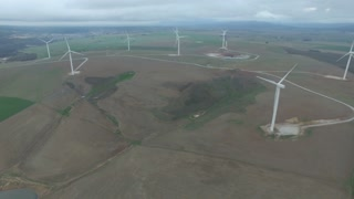 Aerial View Flying Across Wind Farm