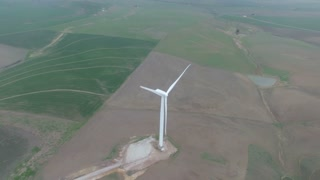 Incredible Shot Flying Over Moving Wind Turbine
