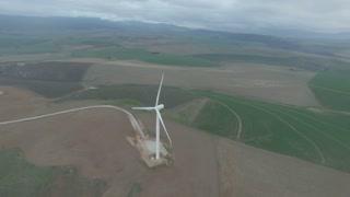 Revolving Around a Spinning Wind Turbine