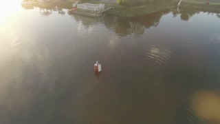 Rowers in Canal at Sunrise Orbiting Aerial Shot
