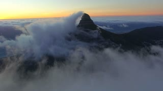 Aerial Lion's Head Mountain Engulfed in a Cloud at Sunset in Cape Town