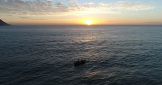 Aerial of Boat Floating in Ocean at Sunset in Cape Town
