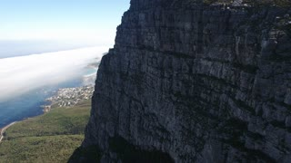 Aerial of Camps Bay and Lion's Head Behind Table Mountain in Cape Town