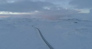 Aerial of Snowy Windy Road Towards Reykjavik Iceland