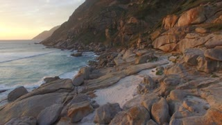 Aerial Pan over Chapman's Peak and Beach during Sunset in Cape Town