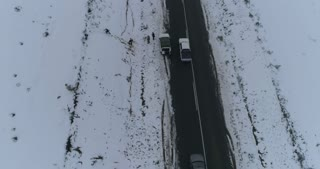 Aerial Reveal Shot of Car In Snowy South African Landscape