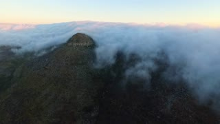 Aerial Time Lapse of Cloudy Peak Engulfed in Clouds