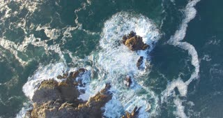 Aerial Time Lapse of Waves Craching over Rocks
