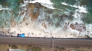 Aerial Vertical Waves Shot with Train Tracks at Kalk Bay