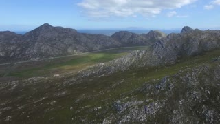Beautiful Coastal Mountains with Road in Distance Aerial View