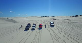 Cars Driving along Sand Dunes in Cape Town Aerial Shot