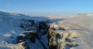 Fjadrargljufur Canyon Aerial View in Snowy Sunset