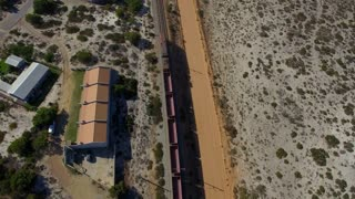 Flying over Moving Train on Beach Coast, South Africa Aerial View