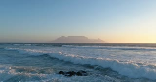 Table Mountain in Cape Town Aerial Flight Over Waves at Sunrise
