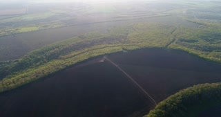 Aerial panorama over patchwork landscape farms fields
