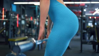 Athlete girl doing front barbell squats