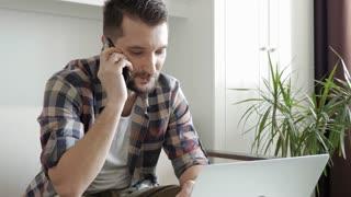 Bearded man having phone conversation on phone