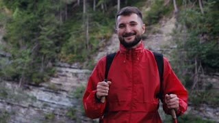 Bearded man hiker posing with backpack