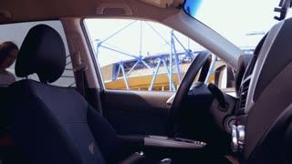 Beautiful pregnant lady fastening car seat belt