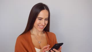Beautiful woman using mobile applications on the smartphone