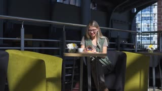 beautiful woman with phone in cafe