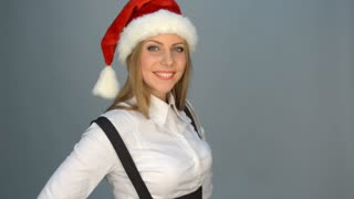 Beautiful young woman in santa claus hat