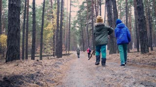 Big family walking in autumn forest