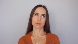 brunette woman making different facial expressions showing boring look
