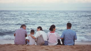 Caucasian family admiring sea view on beach
