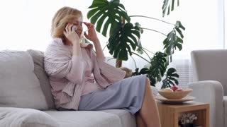Chatty middle-aged woman talking on phone