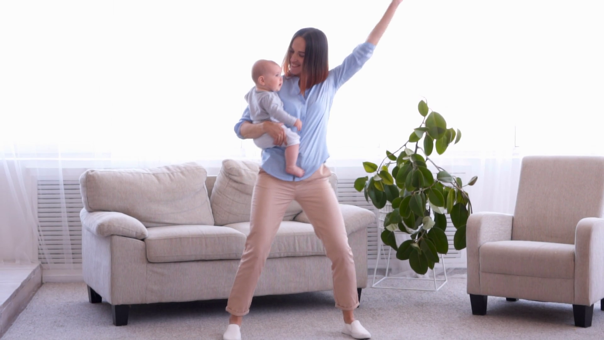 Cool Modern Mother With Little Baby Girl Dancing Together Stock