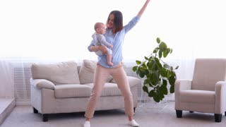 Cool modern mother with little baby girl dancing together