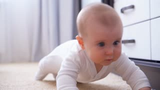 Cute adorable baby crawling on the floor