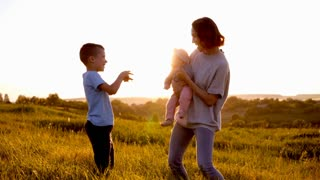 Cute funny family dancing in field and having fun