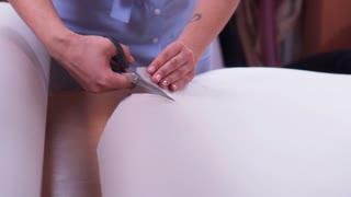 designer making pattern from carton