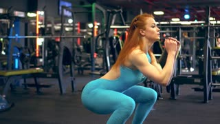 Determined girl doing squat jump
