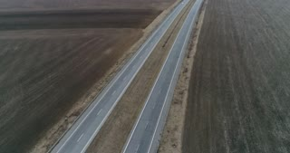 Drone flying up the highway with light traffic