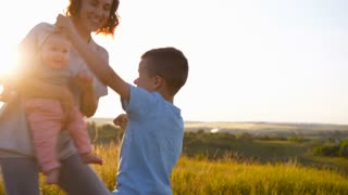 Energetic family dancing together in field
