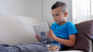 Euphoric boy reaches goal while playing on tablet