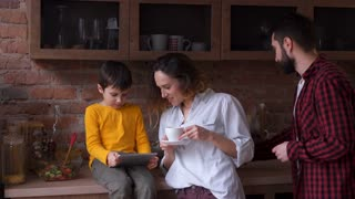 family of three at the kitchen