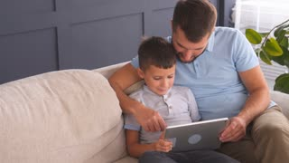 family of three with tablet