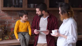 family spending time with coffee and digital tablet