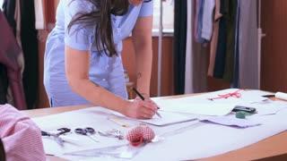 fashion designer drawing sketch of new dress