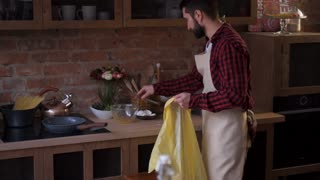 father and son cleaning kitchen after cooking
