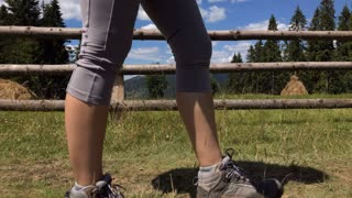 Focus on legs of female hiking in boots and short leggings