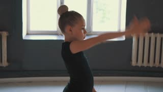 Girl performing rhythmic gymnastics workout with ribbon
