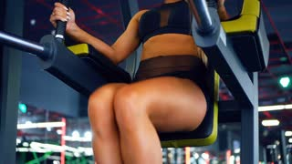 Girl working out abdominal muscles using the captains chair