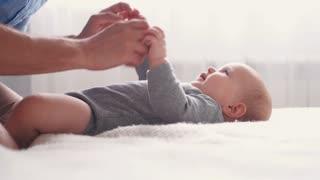 Hands tickling cute little baby