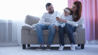 Happy family spending time together on sofa
